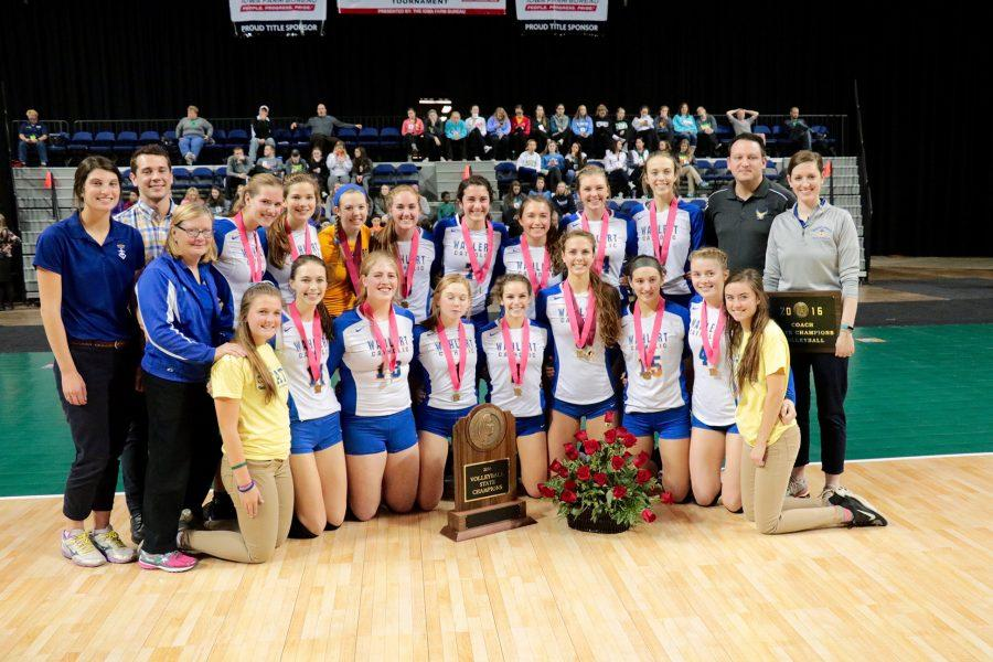Volleyball takes picture after winning state championship in Cedar Rapids.