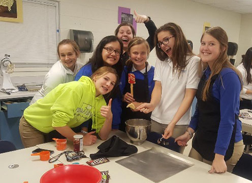 Hannah Scheisl, Jessica Perez, Alaina Schmidt, Christine Kalb, Libby Wedewer, '20, Adrianna Schroeder, '18, and Avery Fair, '20, helped bake cookies for the open house for the incoming freshmen of the 2018-2019 school year.