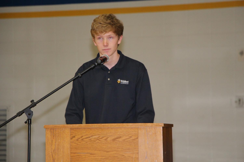 Joe Patrick,'18, sharing a reading at a prayer service.