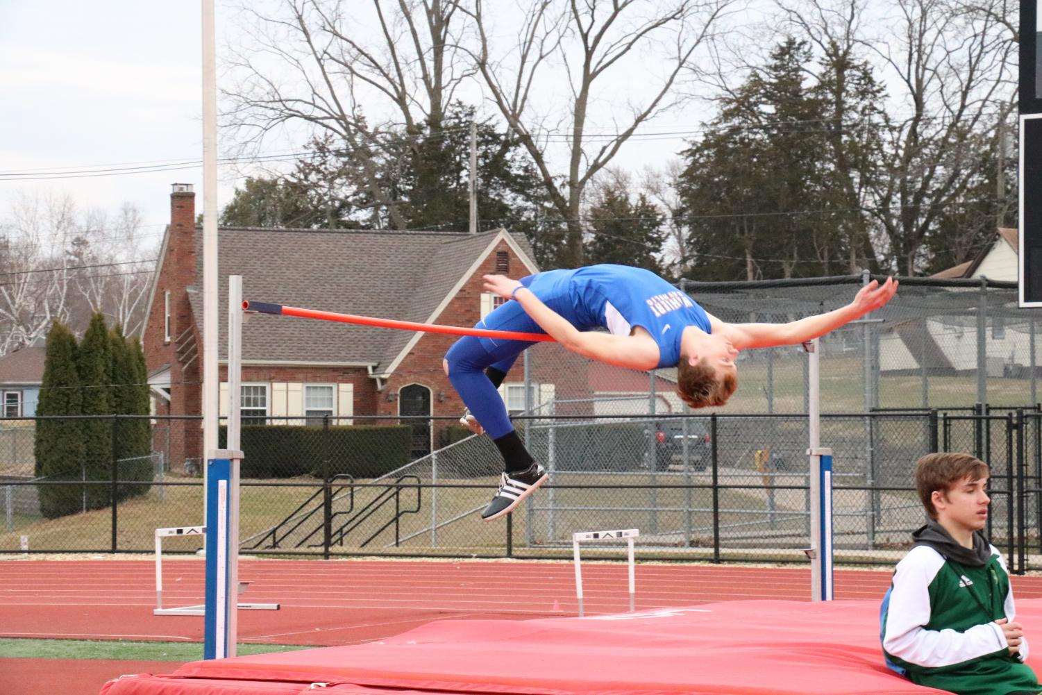 Leaping into state Matt Bandy, '19, competes in high jump. Bandy jumped 6'3 at state which placed him 6th.