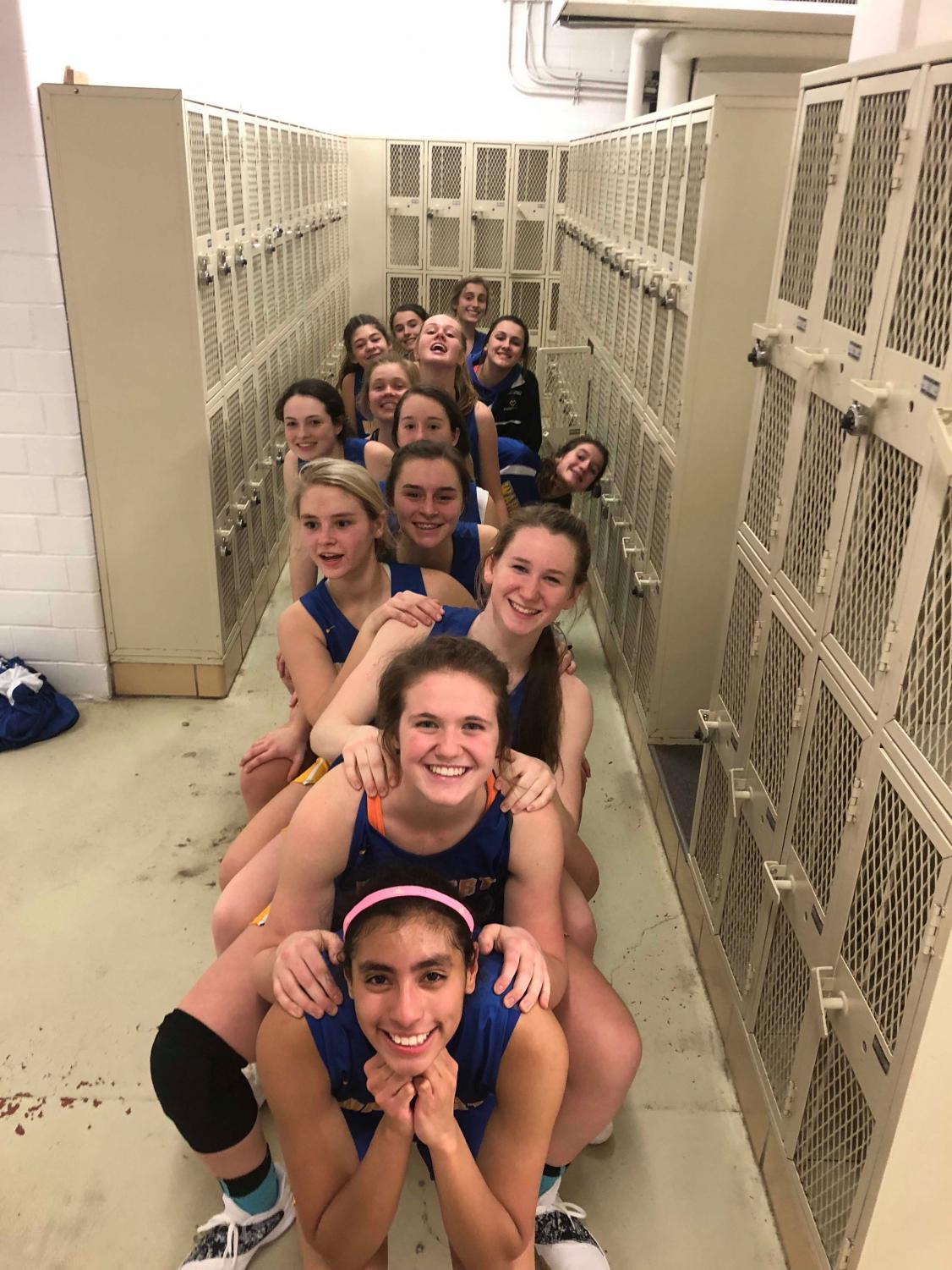 Maria Klein, '19 (front) is the only senior on the Girls' Varsity Basketball team. Despite that, she has looked to former Wahlert athletes and her teammates for encouragement and support. The Eagles come back from break to play Kennedy at 7:30 p.m. Friday, Jan. 4 at Wahlert.