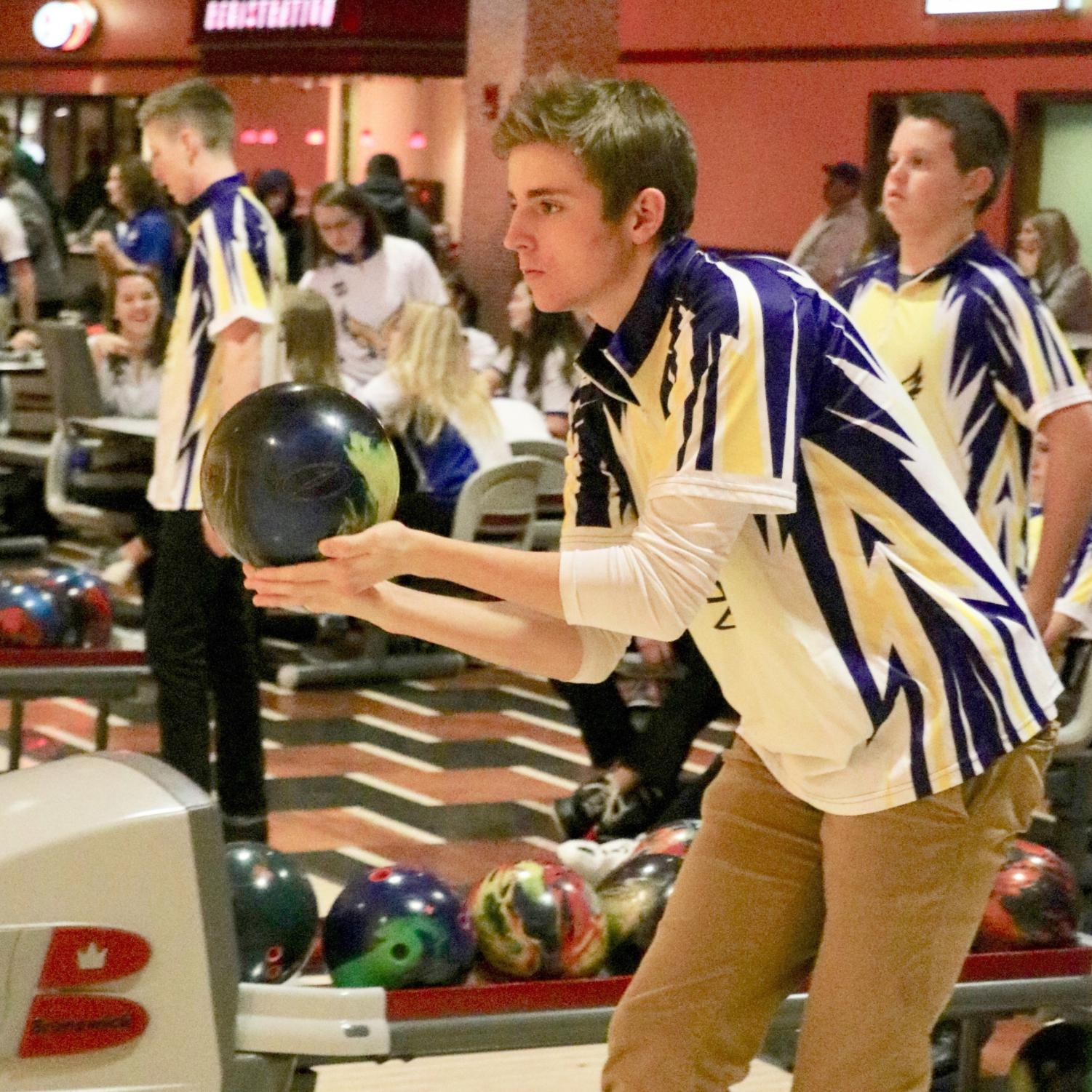 Mitchell Walz '19, prepares to launch the ball down the lane during bowling practice after school at Cherry Lanes.