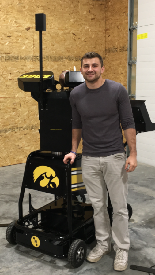 Nate Pierroti, '12, standing next to the Seeker that he created this past year.