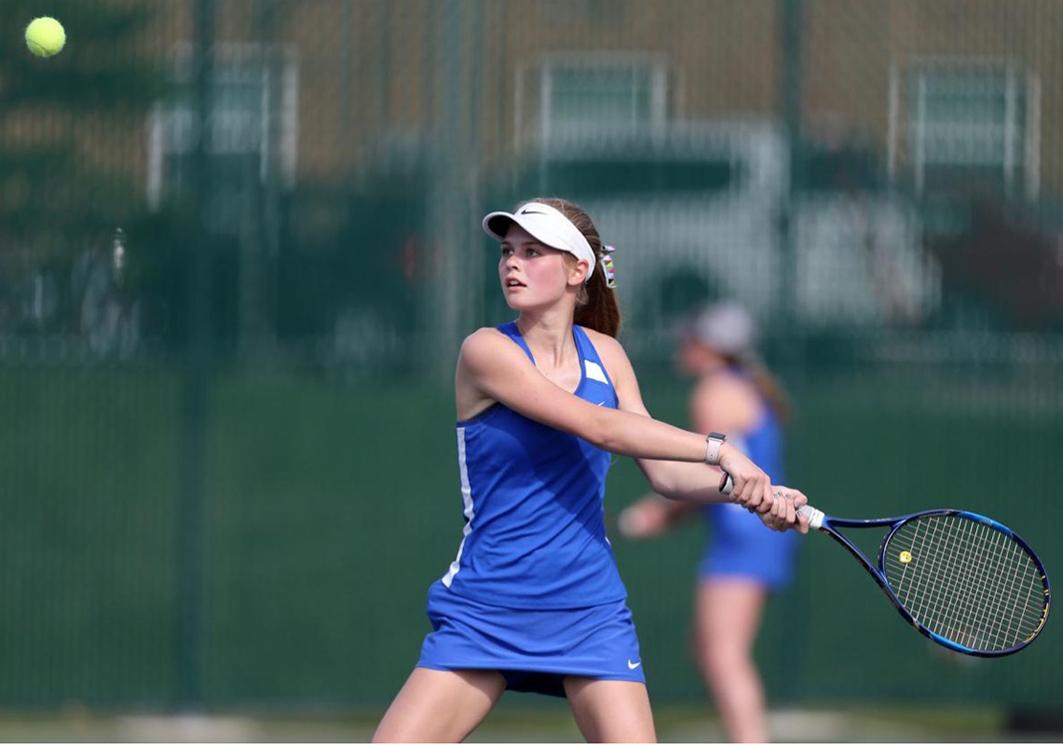 Anna Freiburger returns a volley from an opponent tennis match