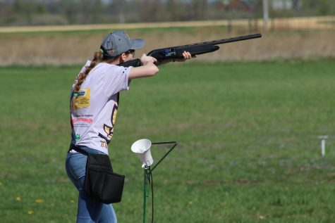 Emily Kasal, '20, shoots at a clay pigeon target at her meet in DeWitt, Iowa.
