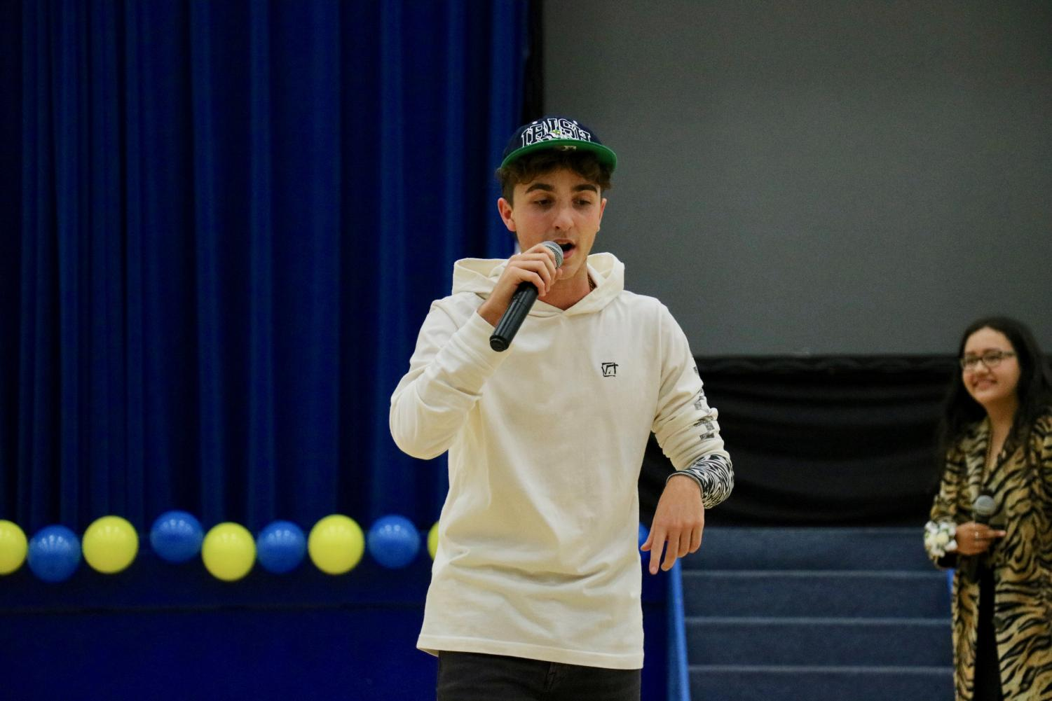 Matteo Barzagli, '20, raps in Italian at the homecoming pep rally.
