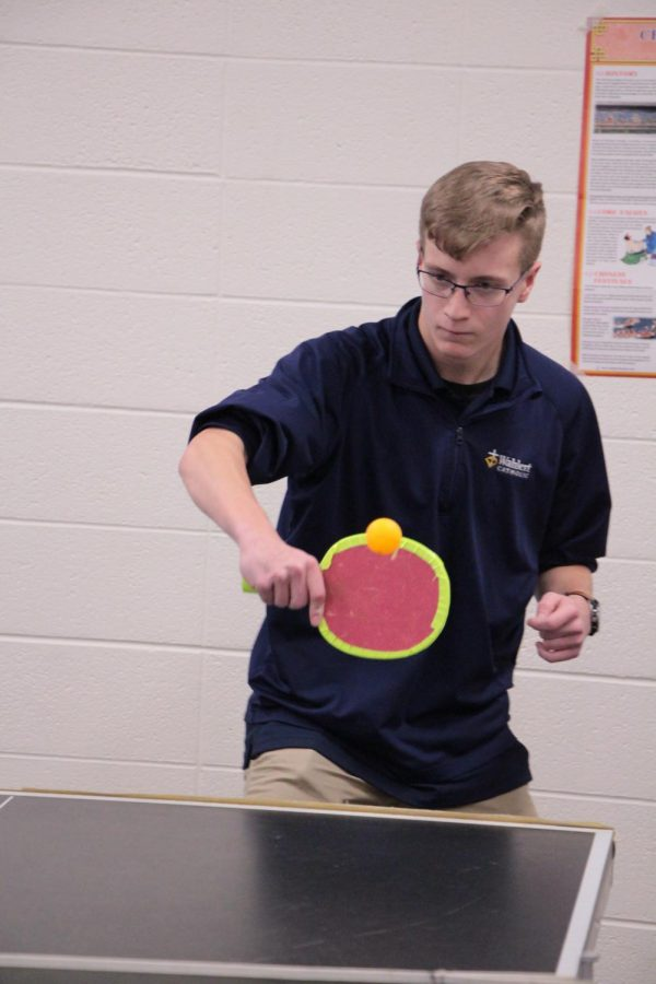 Joe Chapman, '22, practices for the ping pong tournament. Chapman often visits Ms. Nan Li's classroom after school to prepare for the competition.
