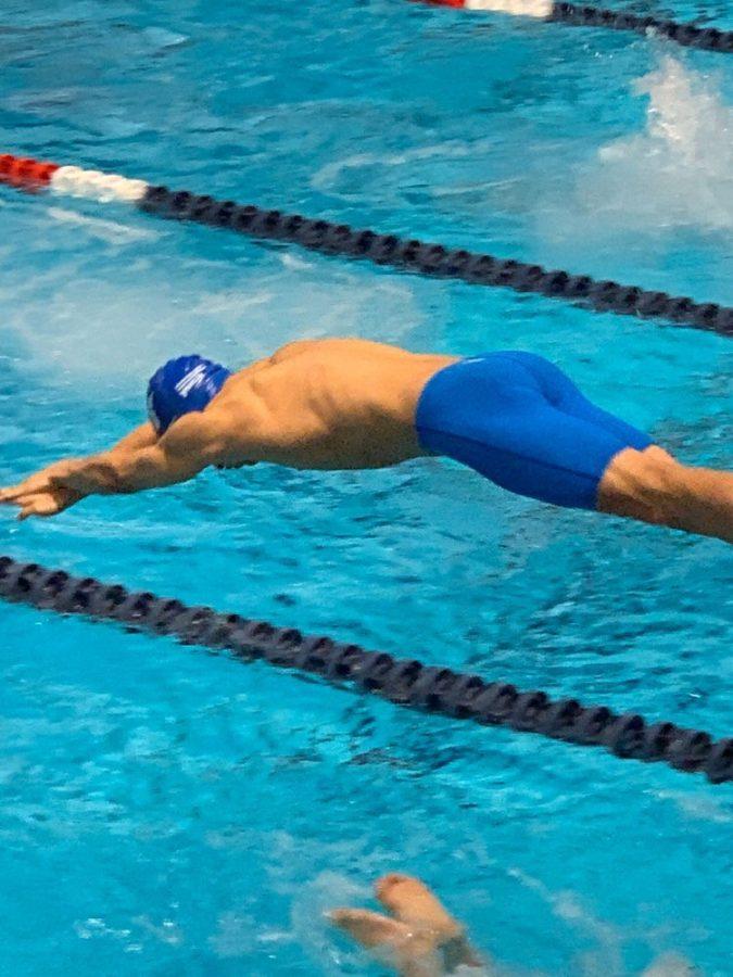 Aiden+Yaklich%2C+%2722%2C+dives+into+a+new+swimming+season%2C+Yaklich+swims+short-distance+for+Hempstead.+