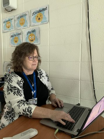 Mrs. Becky Varley enters grades into PowerSchool before meeting with parents this week.