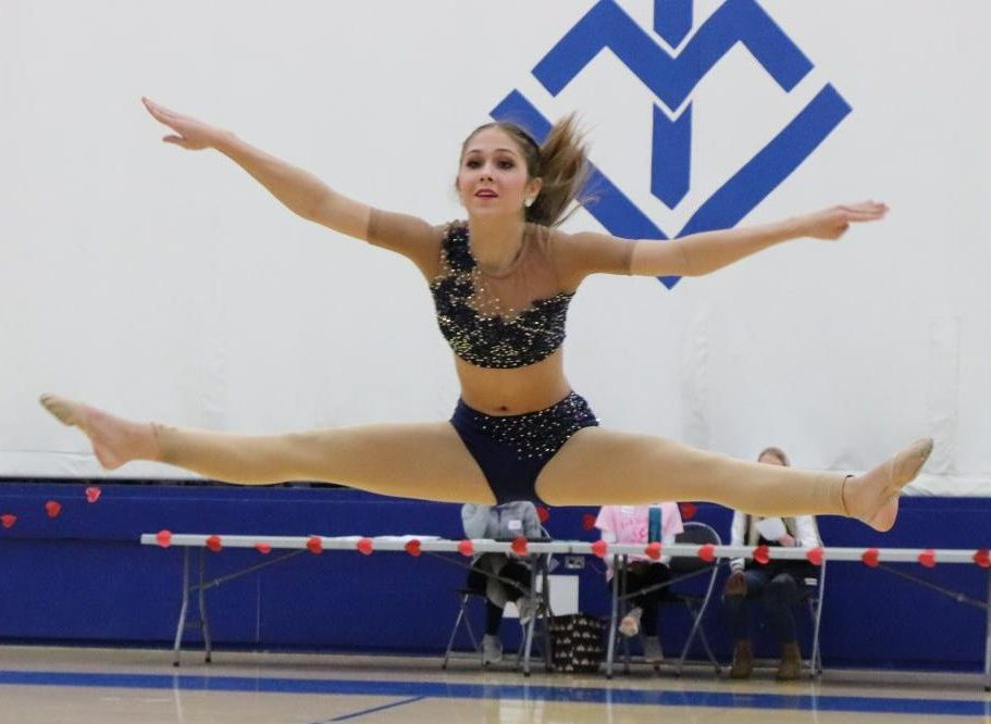 Lizzie Kann, '22, performs a solo routine during the Rock the Rafters showcase, which featured performances from various dance studios, Senior High color guard, and individuals, as well as the Wahlert Dance Team.