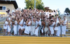 The NEST at the first football game of the season cheering on their classmates.