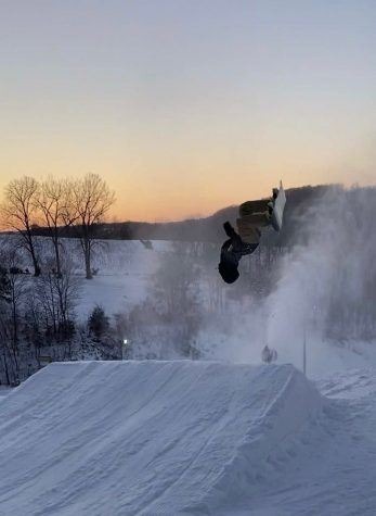 Adam Wagner, '21, at Sundown Mountain doing a backflip.