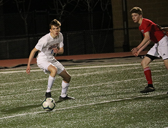 Tyler Dodds, '21, runs after the ball in a game versus Senior during the 2018-2019 season.
