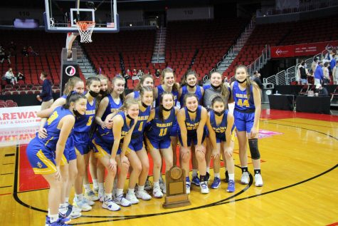 STATE WORTHY The team poses with its state participant trophy at the Wells Fargo Arena in Des Moines. They returned to state for the first time since 2013.