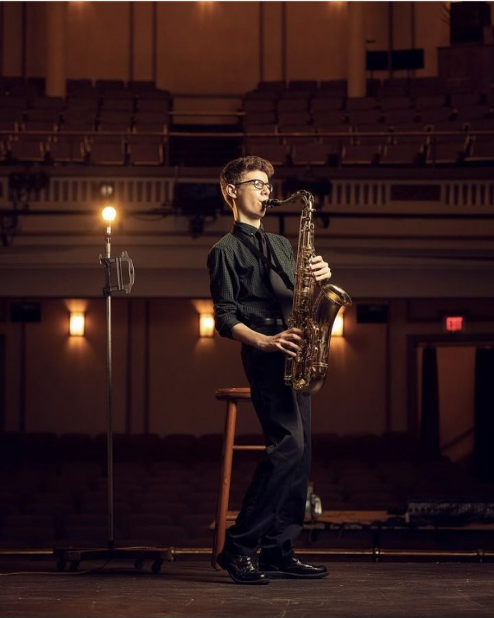 Nicholas Hill, '24, performs on his tenor sax at the Grand Opera House.