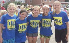 Ana Chandlee, Ariana Yaklich, Hayley Welbes, Abigail Klauer, and Sophie Skemp participate in a fun celebration during elementary at Our Lady of Guadalupe.