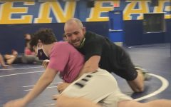 PIN EM DOWN  Mr. Joel Allen demonstrates wrestling moves on Andrew Slaght, 24, during a S.A.C. class.