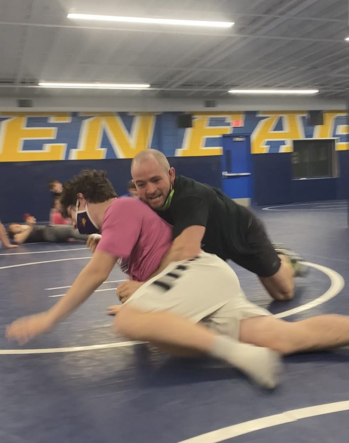 PIN 'EM DOWN  Mr. Joel Allen demonstrates wrestling moves on Andrew Slaght, '24, during a S.A.C. class.